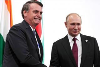 """Putin aplaude las """"cualidades masculinas"""" de Bolsonaro para afrontar la pandemia de COVID-19"""