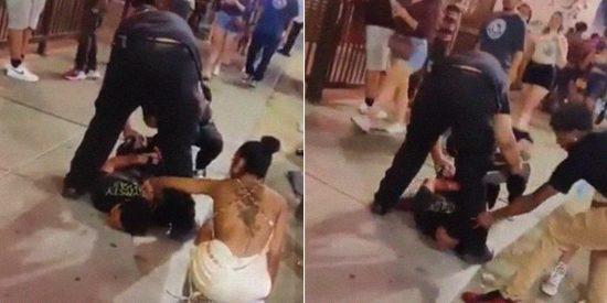Testigos de un arresto tratan de robarle la cadena de oro a un hombre que yace inmovilizado por policías